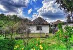 Reality Pôvodný dom s veľkorysou záhradou v malebnej dedinke pri Veľkom Krtíší